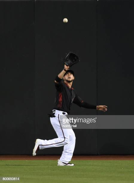 Gregor Blanco of the Arizona Diamondbacks catches a fly ball in center field during the first inning against the Philadelphia Phillies at Chase Field...