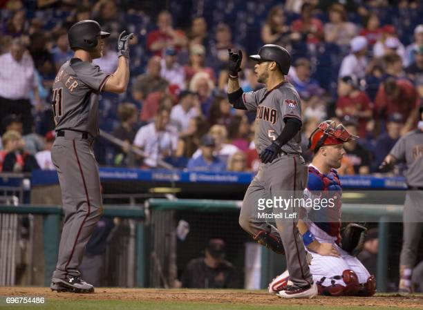 Gregor Blanco of the Arizona Diamondbacks celebrates with Jeremy Hazelbaker after hitting a two run home run in the top of the seventh inning at...
