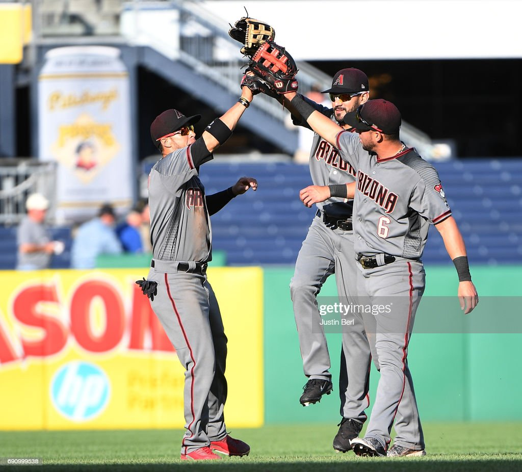 Gregor Blanco #5 of the Arizona Diamondbacks celebrates with Reymond Fuentes #14 and David Peralta #6 after the final out in a 6-5 win over the Pittsburgh Pirates in 14 innings at PNC Park on May 31, 2017 in Pittsburgh, Pennsylvania.