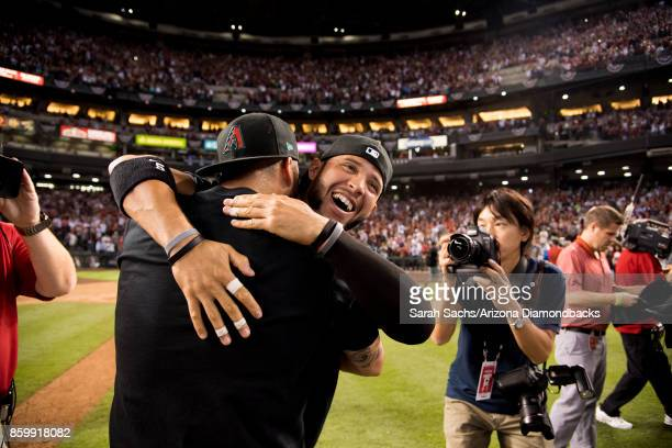 Gregor Blanco of the Arizona Diamondbacks celebrates with teammates after defeating the Colorado Rockies in the National League Wild Card Game at...