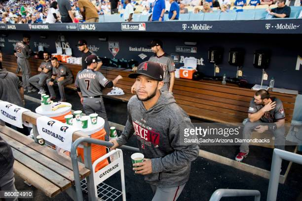 Gregor Blanco of the Arizona Diamondbacks hangs out in the dugout prior to Game Two of the National League Division Series against the Los Angeles...