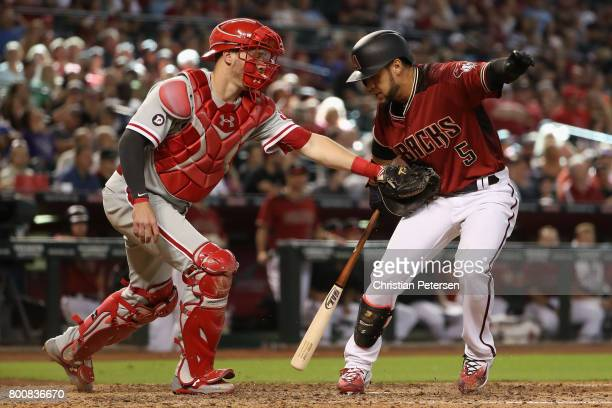 Gregor Blanco of the Arizona Diamondbacks is tagged by catcher Andrew Knapp of the Philadelphia Phillies after striking out during the eighth inning...
