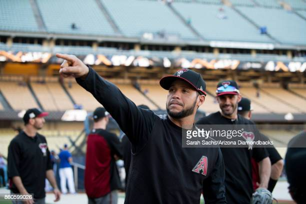 Gregor Blanco of the Arizona Diamondbacks points while working out prior to game one of the National League Division Series against the Los Angeles...
