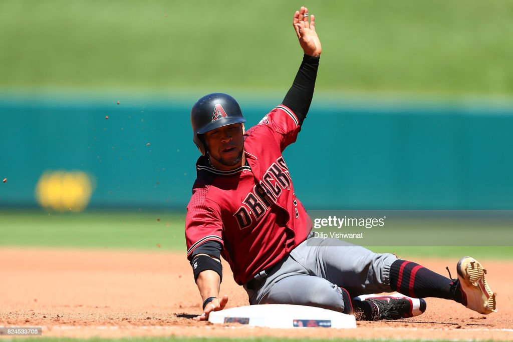 Gregor Blanco #5 of the Arizona Diamondbacks slides safely into first base after getting caught in a rundown against the Arizona Diamondbacks in the fourth inning at Busch Stadium on July 30, 2017 in St. Louis, Missouri.