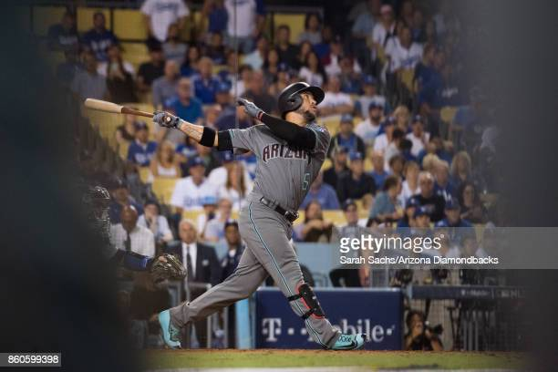 Gregor Blanco of the Arizona Diamondbacks swings the bat during game one of the National League Division Series against the Los Angeles Dodgers at...