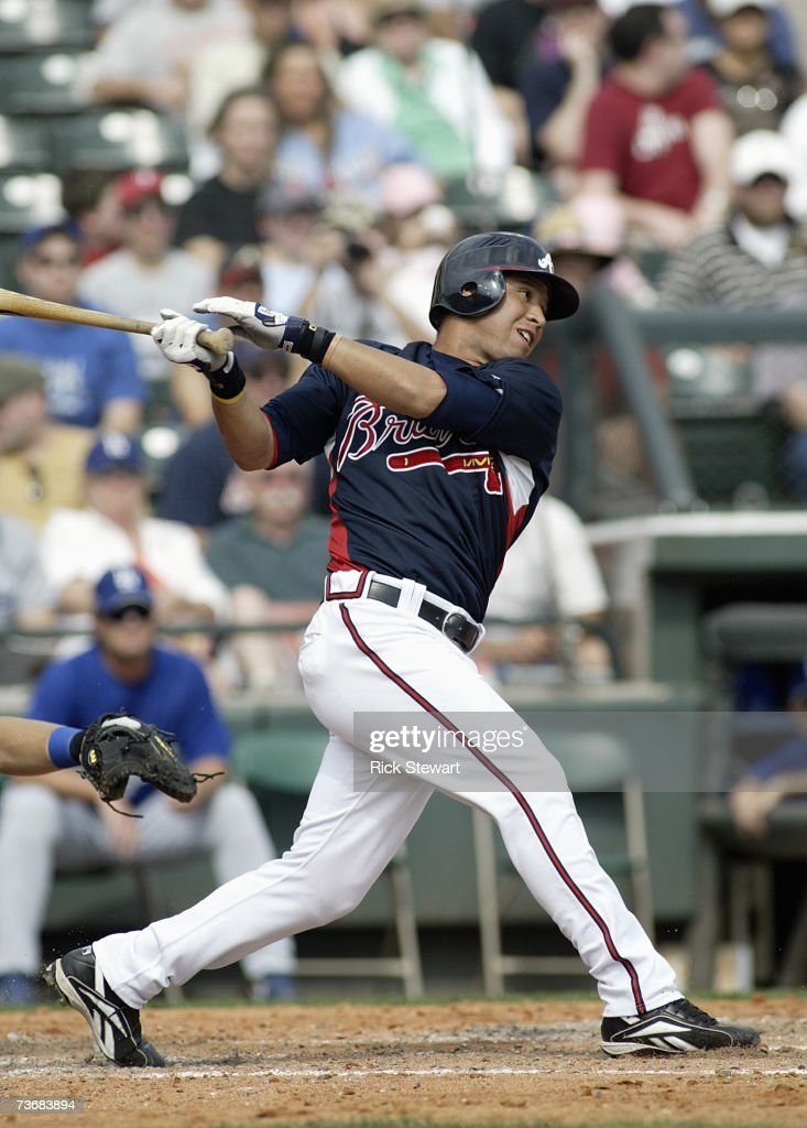Gregor Blanco of the Atlanta Braves swings at the pitch during a Spring Training game against the Los Angeles Dodgers on March 12007 at The Ballpark...