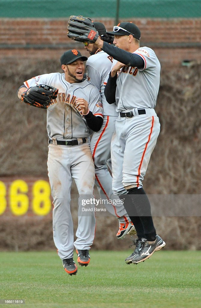 L-R Gregor Blanco #7 of the San Francisco Giants, Angel Pagan #16 and <a gi-track='captionPersonalityLinkClicked' href=/galleries/search?phrase=Hunter+Pence&family=editorial&specificpeople=757341 ng-click='$event.stopPropagation()'>Hunter Pence</a> #8 celebrate their win against the Chicago Cubs on April 13, 2013 at Wrigley Field in Chicago, Illinois. The San Francisco Giants defeated the Chicago Cubs 3-2.