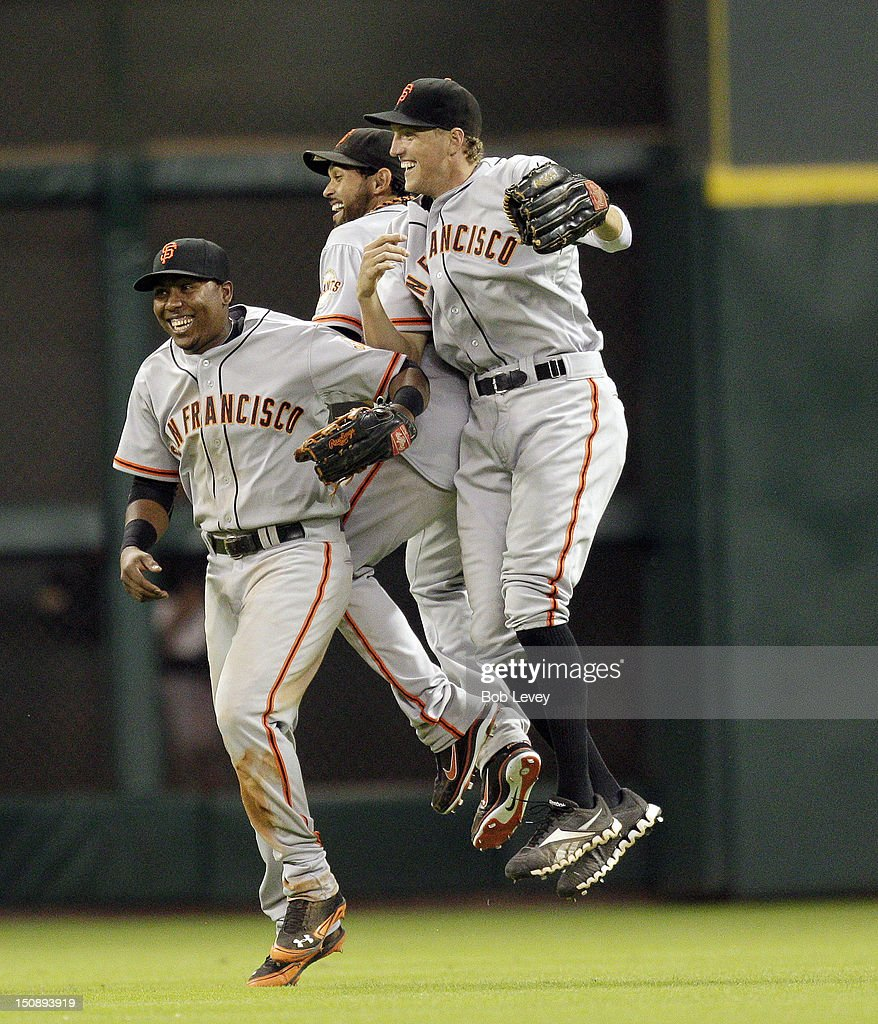 <a gi-track='captionPersonalityLinkClicked' href=/galleries/search?phrase=Gregor+Blanco&family=editorial&specificpeople=4137600 ng-click='$event.stopPropagation()'>Gregor Blanco</a> #7 of the San Francisco Giants, <a gi-track='captionPersonalityLinkClicked' href=/galleries/search?phrase=Angel+Pagan&family=editorial&specificpeople=666596 ng-click='$event.stopPropagation()'>Angel Pagan</a> #16 of the San Francisco Giants and <a gi-track='captionPersonalityLinkClicked' href=/galleries/search?phrase=Hunter+Pence&family=editorial&specificpeople=757341 ng-click='$event.stopPropagation()'>Hunter Pence</a> #8 of the San Francisco Giants celebrate after defeating the Houston Astros 3-2 at Minute Maid Park on August 28, 2012 in Houston, Texas.