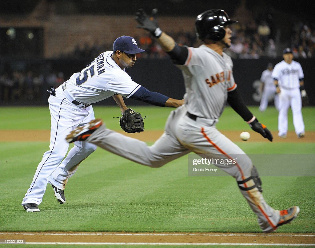<a gi-track='captionPersonalityLinkClicked' href=/galleries/search?phrase=Gregor+Blanco&family=editorial&specificpeople=4137600 ng-click='$event.stopPropagation()'>Gregor Blanco</a> #7 of the San Francisco Giants beats the throw by Jesus Guzman #15 of the San Diego Padres to first base during the seventh inning of a baseball game at Petco Park on July 11, 2013 in San Diego, California.