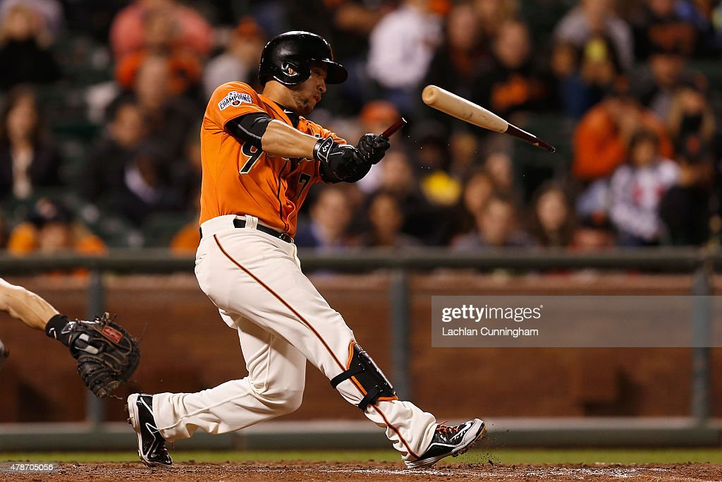 <a gi-track='captionPersonalityLinkClicked' href=/galleries/search?phrase=Gregor+Blanco&family=editorial&specificpeople=4137600 ng-click='$event.stopPropagation()'>Gregor Blanco</a> #7 of the San Francisco Giants breaks his bat as he hits an RBI single in the ninth inning against the Colorado Rockies at AT&T Park on June 26, 2015 in San Francisco, California.