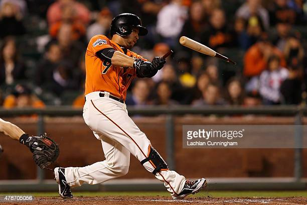 Gregor Blanco of the San Francisco Giants breaks his bat as he hits an RBI single in the ninth inning against the Colorado Rockies at ATT Park on...