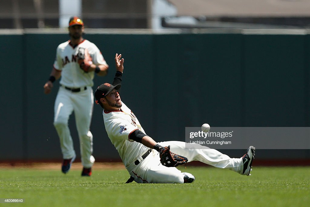 <a gi-track='captionPersonalityLinkClicked' href=/galleries/search?phrase=Gregor+Blanco&family=editorial&specificpeople=4137600 ng-click='$event.stopPropagation()'>Gregor Blanco</a> #7 of the San Francisco Giants catches a fly ball off the bat of Billy Burns of the Oakland Athletics in the first inning at AT&T Park on July 26, 2015 in San Francisco, California.