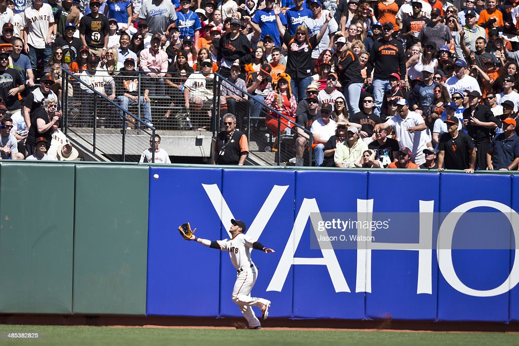 <a gi-track='captionPersonalityLinkClicked' href=/galleries/search?phrase=Gregor+Blanco&family=editorial&specificpeople=4137600 ng-click='$event.stopPropagation()'>Gregor Blanco</a> #7 of the San Francisco Giants catches a fly ball off the bat of Scott Van Slyke (not pictured) of the Los Angeles Dodgers during the sixth inning at AT&T Park on April 17, 2014 in San Francisco, California.