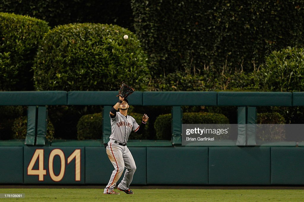 <a gi-track='captionPersonalityLinkClicked' href=/galleries/search?phrase=Gregor+Blanco&family=editorial&specificpeople=4137600 ng-click='$event.stopPropagation()'>Gregor Blanco</a> #7 of the San Francisco Giants catches a long fly in the seventh inning of the game against the Philadelphia Phillies at Citizens Bank Park on July 31, 2013 in Philadelphia, Pennsylvania. The Giants won 9-2.