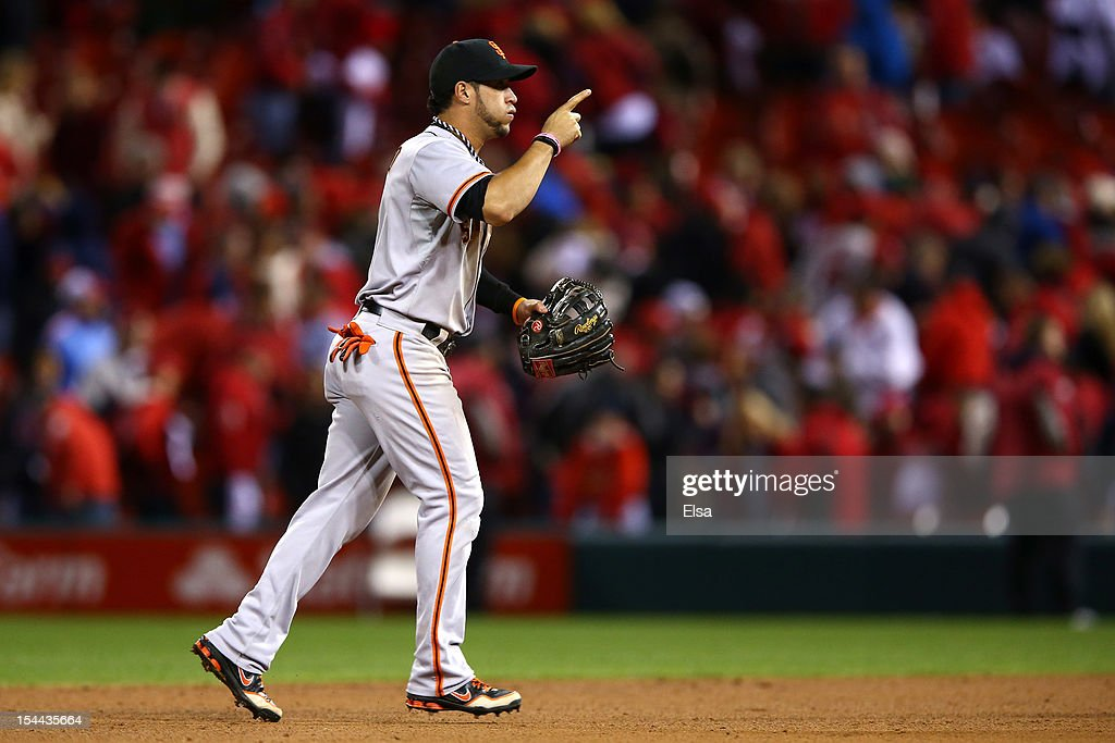 <a gi-track='captionPersonalityLinkClicked' href=/galleries/search?phrase=Gregor+Blanco&family=editorial&specificpeople=4137600 ng-click='$event.stopPropagation()'>Gregor Blanco</a> #7 of the San Francisco Giants celebrates the Giants 5-0 victory in Game Five of the National League Championship Series at Busch Stadium on October 19, 2012 in St Louis, Missouri.