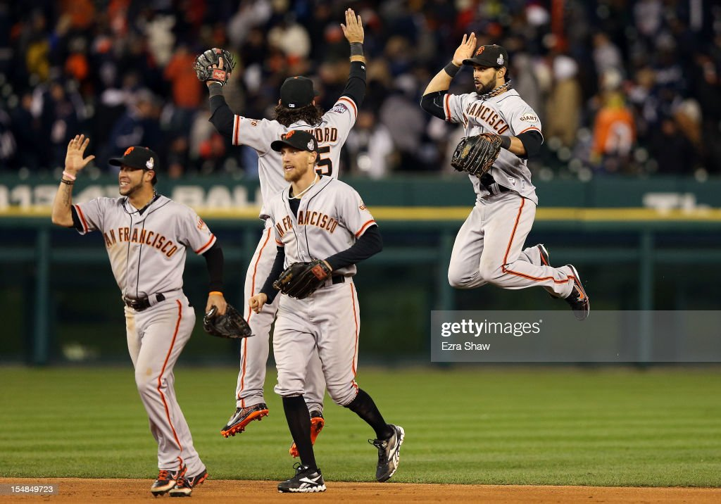 Gregor Blanco #7 of the San Francisco Giants celebrates with teammates Hunter Pence #8, Brandon Crawford #35 and Angel Pagan #16 after defeating the Detroit Tigers in Game Three of the Major League Baseball World Series at Comerica Park on October 27, 2012 in Detroit, Michigan. The San Francisco Giants defeated the Detroit Tigers 2-0.