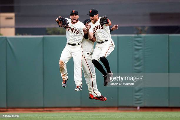 Gregor Blanco of the San Francisco Giants Denard Span and Hunter Pence celebrate after the game against the Los Angeles Dodgers at ATT Park on April...