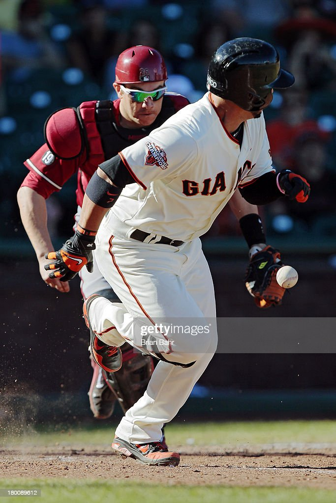 <a gi-track='captionPersonalityLinkClicked' href=/galleries/search?phrase=Gregor+Blanco&family=editorial&specificpeople=4137600 ng-click='$event.stopPropagation()'>Gregor Blanco</a> #7 of the San Francisco Giants gets on base with a bunt single to advance the winning run to second base against the Arizona Diamondbacks in the 11th inning at AT&T Park on September 8, 2013 in San Francisco, California. The Giants won 3-2 in 11 innnings.