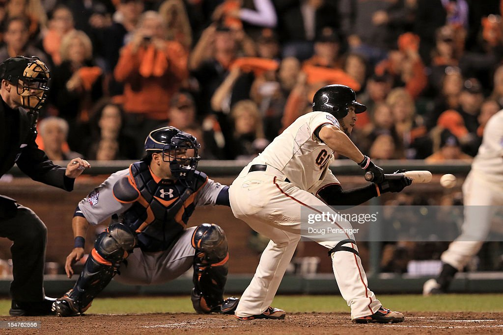 Gregor Blanco #7 of the San Francisco Giants hits a bunt single in the seventh inning against the Detroit Tigers during Game Two of the Major League Baseball World Series at AT&T Park on October 25, 2012 in San Francisco, California.