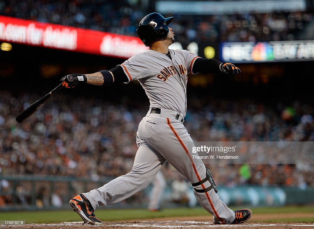 <a gi-track='captionPersonalityLinkClicked' href=/galleries/search?phrase=Gregor+Blanco&family=editorial&specificpeople=4137600 ng-click='$event.stopPropagation()'>Gregor Blanco</a> #7 of the San Francisco Giants hits a sacrifice fly scoring Brandon Crawford #35 in the second inning against the Cincinnati Reds at AT&T Park on July 23, 2013 in San Francisco, California.