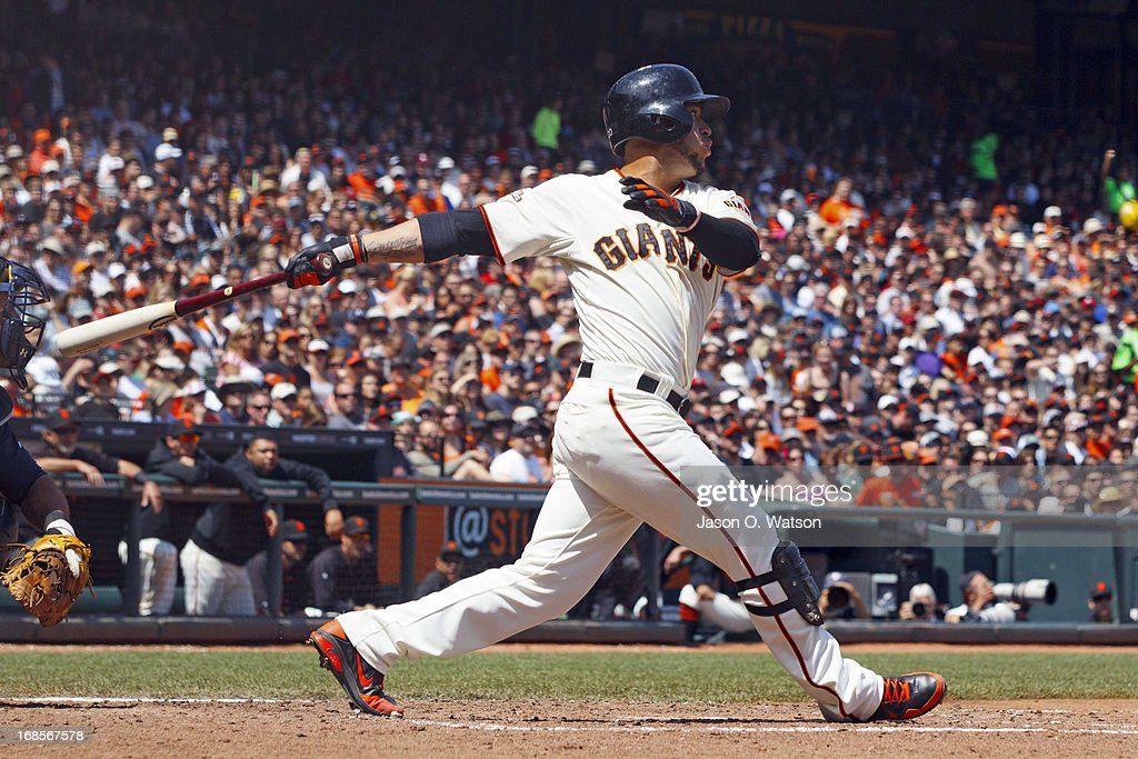 <a gi-track='captionPersonalityLinkClicked' href=/galleries/search?phrase=Gregor+Blanco&family=editorial&specificpeople=4137600 ng-click='$event.stopPropagation()'>Gregor Blanco</a> #7 of the San Francisco Giants hits a three-RBI double against the Atlanta Braves during the fifth inning at AT&T Park on May 11, 2013 in San Francisco, California.