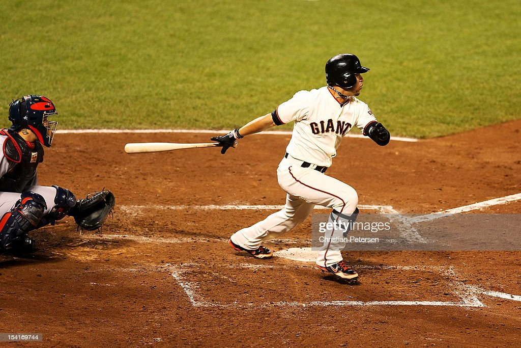 <a gi-track='captionPersonalityLinkClicked' href=/galleries/search?phrase=Gregor+Blanco&family=editorial&specificpeople=4137600 ng-click='$event.stopPropagation()'>Gregor Blanco</a> #7 of the San Francisco Giants hits a two RBI triple in the fourth inning of Game One of the National League Championship Series against the St. Louis Cardinals at AT&T Park on October 14, 2012 in San Francisco, California.