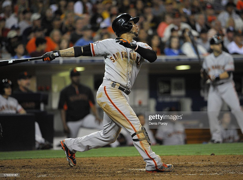 <a gi-track='captionPersonalityLinkClicked' href=/galleries/search?phrase=Gregor+Blanco&family=editorial&specificpeople=4137600 ng-click='$event.stopPropagation()'>Gregor Blanco</a> #7 of the San Francisco Giants hits an RBI double during the eighth inning of a baseball game against the San Diego Padres at Petco Park on July 11, 2013 in San Diego, California.