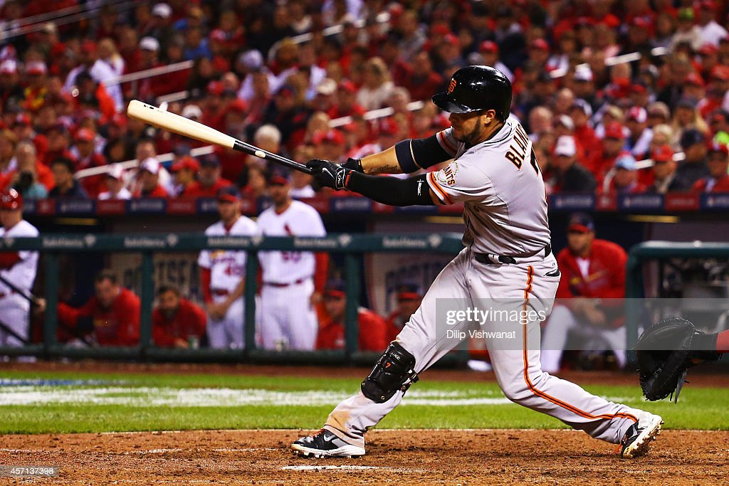 <a gi-track='captionPersonalityLinkClicked' href=/galleries/search?phrase=Gregor+Blanco&family=editorial&specificpeople=4137600 ng-click='$event.stopPropagation()'>Gregor Blanco</a> #7 of the San Francisco Giants hits an RBI single scoring Brandon Crawford #35 in the seventh inning against the St. Louis Cardinals during Game Two of the National League Championship Series at Busch Stadium on October 12, 2014 in St Louis, Missouri.