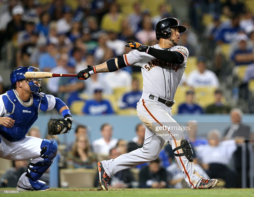 <a gi-track='captionPersonalityLinkClicked' href=/galleries/search?phrase=Gregor+Blanco&family=editorial&specificpeople=4137600 ng-click='$event.stopPropagation()'>Gregor Blanco</a> #7 of the San Francisco Giants hits an RBI single to tie the game in the ninth inning against the Los Angeles Dodgers at Dodger Stadium on September 12, 2013 in Los Angeles, California.