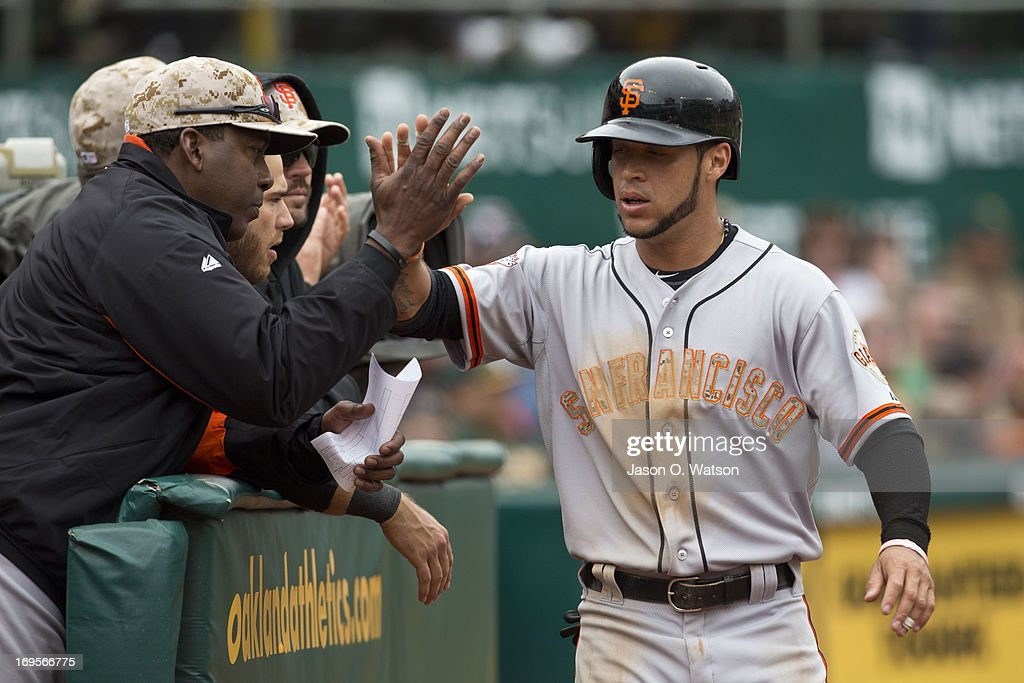 <a gi-track='captionPersonalityLinkClicked' href=/galleries/search?phrase=Gregor+Blanco&family=editorial&specificpeople=4137600 ng-click='$event.stopPropagation()'>Gregor Blanco</a> #7 of the San Francisco Giants is congratulated by teammates after scoring a run against the Oakland Athletics during the sixth inning of the interleague game at O.co Coliseum on May 27, 2013 in Oakland, California.