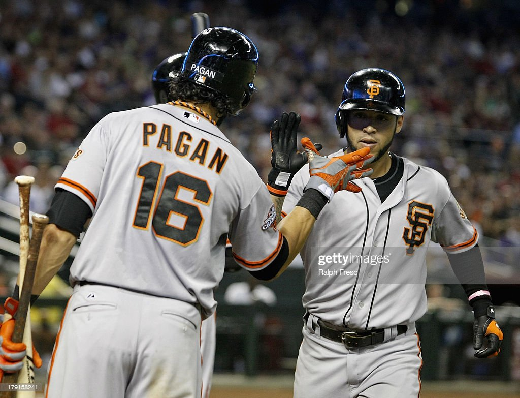 <a gi-track='captionPersonalityLinkClicked' href=/galleries/search?phrase=Gregor+Blanco&family=editorial&specificpeople=4137600 ng-click='$event.stopPropagation()'>Gregor Blanco</a> #7 of the San Francisco Giants is congratulated by teammate <a gi-track='captionPersonalityLinkClicked' href=/galleries/search?phrase=Angel+Pagan&family=editorial&specificpeople=666596 ng-click='$event.stopPropagation()'>Angel Pagan</a> #16 following his solo home run against the Arizona Diamondbacks during the seventh inning of a MLB game at Chase Field on August 31, 2013 in Phoenix, Arizona.
