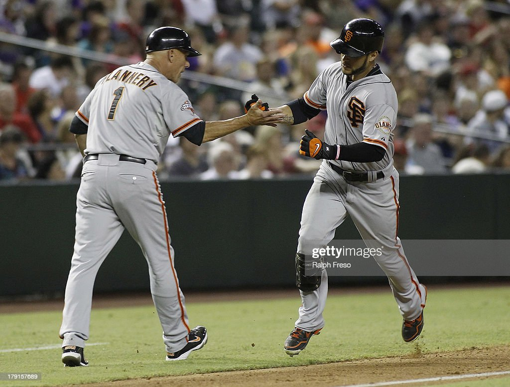 <a gi-track='captionPersonalityLinkClicked' href=/galleries/search?phrase=Gregor+Blanco&family=editorial&specificpeople=4137600 ng-click='$event.stopPropagation()'>Gregor Blanco</a> #7 of the San Francisco Giants is congratulated by third base coach <a gi-track='captionPersonalityLinkClicked' href=/galleries/search?phrase=Tim+Flannery&family=editorial&specificpeople=691944 ng-click='$event.stopPropagation()'>Tim Flannery</a> #1 following his solo home run against the Arizona Diamondbacks during the seventh inning of a MLB game at Chase Field on August 31, 2013 in Phoenix, Arizona.