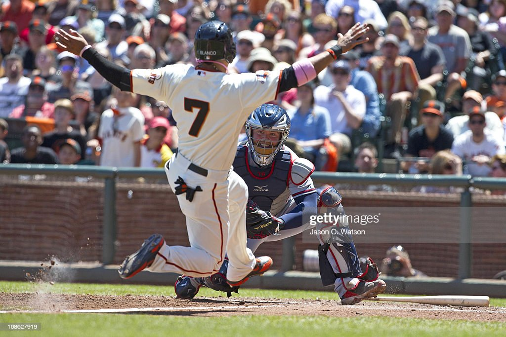 <a gi-track='captionPersonalityLinkClicked' href=/galleries/search?phrase=Gregor+Blanco&family=editorial&specificpeople=4137600 ng-click='$event.stopPropagation()'>Gregor Blanco</a> #7 of the San Francisco Giants is tagged out at home plate by <a gi-track='captionPersonalityLinkClicked' href=/galleries/search?phrase=Brian+McCann+-+Baseball+Player&family=editorial&specificpeople=593065 ng-click='$event.stopPropagation()'>Brian McCann</a> #16 of the Atlanta Braves during the fourth inning at AT&T Park on May 12, 2013 in San Francisco, California.