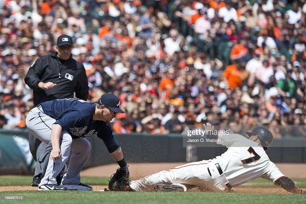 <a gi-track='captionPersonalityLinkClicked' href=/galleries/search?phrase=Gregor+Blanco&family=editorial&specificpeople=4137600 ng-click='$event.stopPropagation()'>Gregor Blanco</a> #7 of the San Francisco Giants is tagged out attempting to steal third base by Chris Johnson #23 of the Atlanta Braves during the fifth inning at AT&T Park on May 11, 2013 in San Francisco, California.