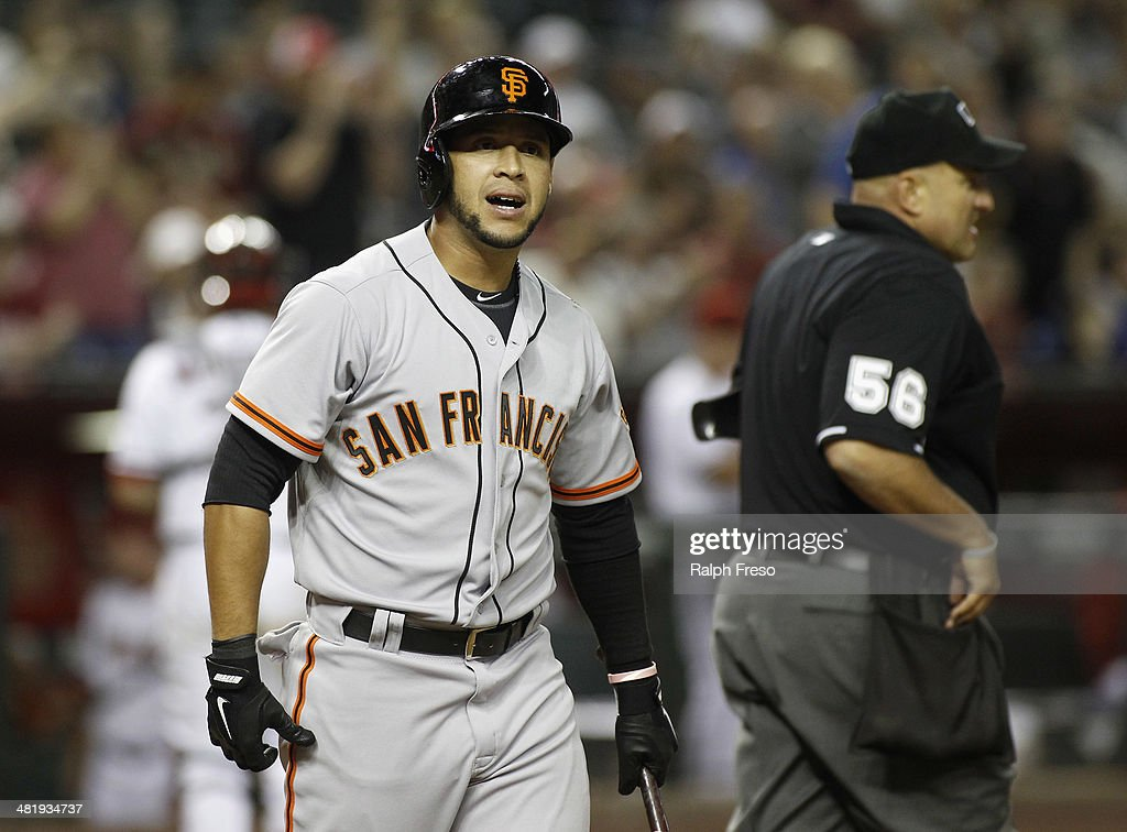 <a gi-track='captionPersonalityLinkClicked' href=/galleries/search?phrase=Gregor+Blanco&family=editorial&specificpeople=4137600 ng-click='$event.stopPropagation()'>Gregor Blanco</a> #7 of the San Francisco Giants reacts after being called out on strikes by home plate umpire Eric Cooper during the eighth inning of a MLB game against the Arizona Diamondbacks at Chase Field on April 1, 2014 in Phoenix, Arizona. The Diamondbacks defeated the Giants 5-4.