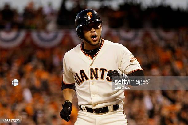 Gregor Blanco of the San Francisco Giants reacts after he is walked scoring Brandon Crawford during Game Four of the National League Division Series...