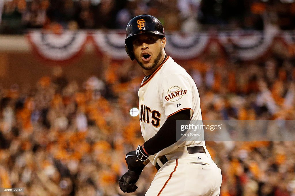 <a gi-track='captionPersonalityLinkClicked' href=/galleries/search?phrase=Gregor+Blanco&family=editorial&specificpeople=4137600 ng-click='$event.stopPropagation()'>Gregor Blanco</a> #7 of the San Francisco Giants reacts after he is walked, scoring Brandon Crawford #35 during Game Four of the National League Division Series against the Washington Nationals at AT&T Park on October 7, 2014 in San Francisco, California.