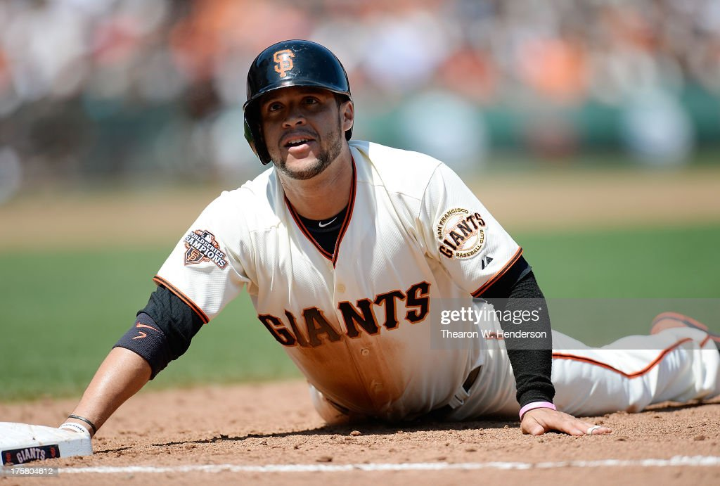 <a gi-track='captionPersonalityLinkClicked' href=/galleries/search?phrase=Gregor+Blanco&family=editorial&specificpeople=4137600 ng-click='$event.stopPropagation()'>Gregor Blanco</a> #7 of the San Francisco Giants reacts after he was doubled off of first base on a failed sacrifice bunt attempt from Tim Lincecum #55 in the six inning against the Milwaukee Brewers at AT&T Park on August 8, 2013 in San Francisco, California.