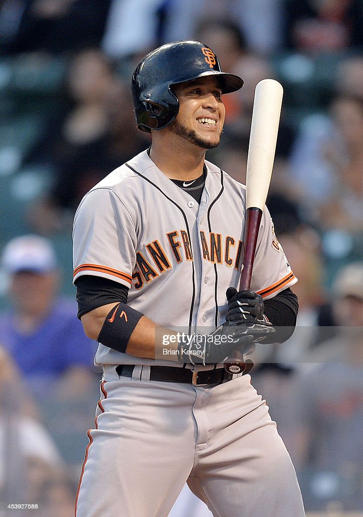 <a gi-track='captionPersonalityLinkClicked' href=/galleries/search?phrase=Gregor+Blanco&family=editorial&specificpeople=4137600 ng-click='$event.stopPropagation()'>Gregor Blanco</a> #7 of the San Francisco Giants reacts after striking out during the ninth inning of a resumed game against the Chicago Cubs at Wrigley Field on August 21, 2014 in Chicago, Illinois. The game was initially called off in the early morning hours of August 20 over a protest from the Giants. Major League Baseball accepted the Giants' appeal, ruling the delay was caused by a mechanical failure of the tarp and changing the status of the game from cancelled and completed with a Cubs 2-0 win to a suspended game. The Cubs defeated the Giants 2-1.