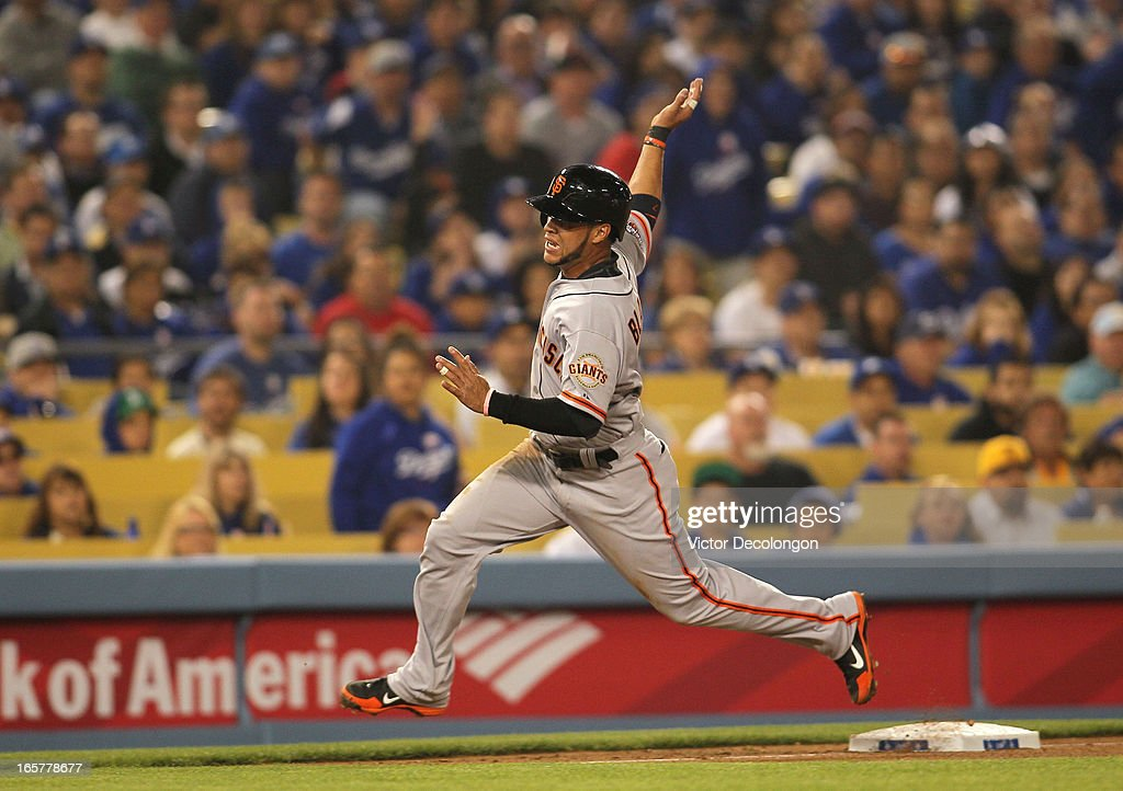 <a gi-track='captionPersonalityLinkClicked' href=/galleries/search?phrase=Gregor+Blanco&family=editorial&specificpeople=4137600 ng-click='$event.stopPropagation()'>Gregor Blanco</a> #7 of the San Francisco Giants runs past the third base bag in the third inning on a double by Brandon Crawford #35 (not in photo) against the Los Angeles Dodgers during the MLB game at Dodger Stadium on April 3, 2013 in Los Angeles, California. The Giants defeated the Dodgers 5-3.