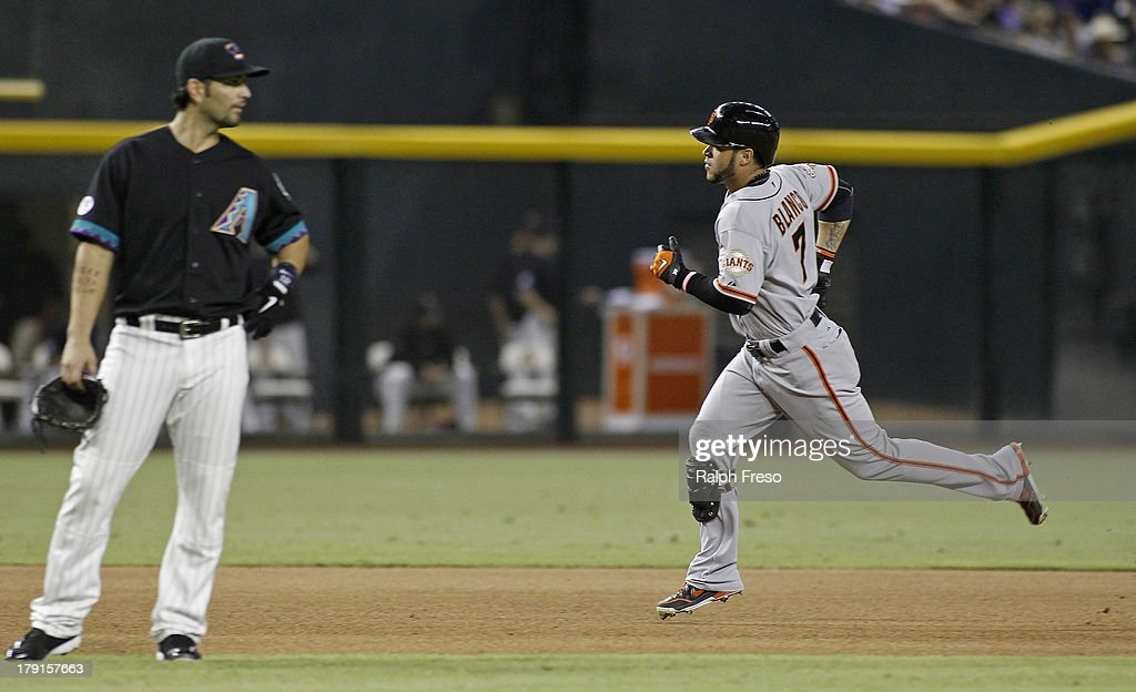 <a gi-track='captionPersonalityLinkClicked' href=/galleries/search?phrase=Gregor+Blanco&family=editorial&specificpeople=4137600 ng-click='$event.stopPropagation()'>Gregor Blanco</a> #7 of the San Francisco Giants runs past third baseman <a gi-track='captionPersonalityLinkClicked' href=/galleries/search?phrase=Eric+Chavez&family=editorial&specificpeople=201561 ng-click='$event.stopPropagation()'>Eric Chavez</a> #12 of the Arizona Diamondbacks following his solo home run during the seventh inning of a MLB game at Chase Field on August 31, 2013 in Phoenix, Arizona.