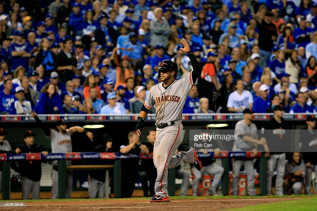 <a gi-track='captionPersonalityLinkClicked' href=/galleries/search?phrase=Gregor+Blanco&family=editorial&specificpeople=4137600 ng-click='$event.stopPropagation()'>Gregor Blanco</a> #7 of the San Francisco Giants score in the first inning against the Kansas City Royals in the first inning during Game One of the 2014 World Series at Kauffman Stadium on October 21, 2014 in Kansas City, Missouri.