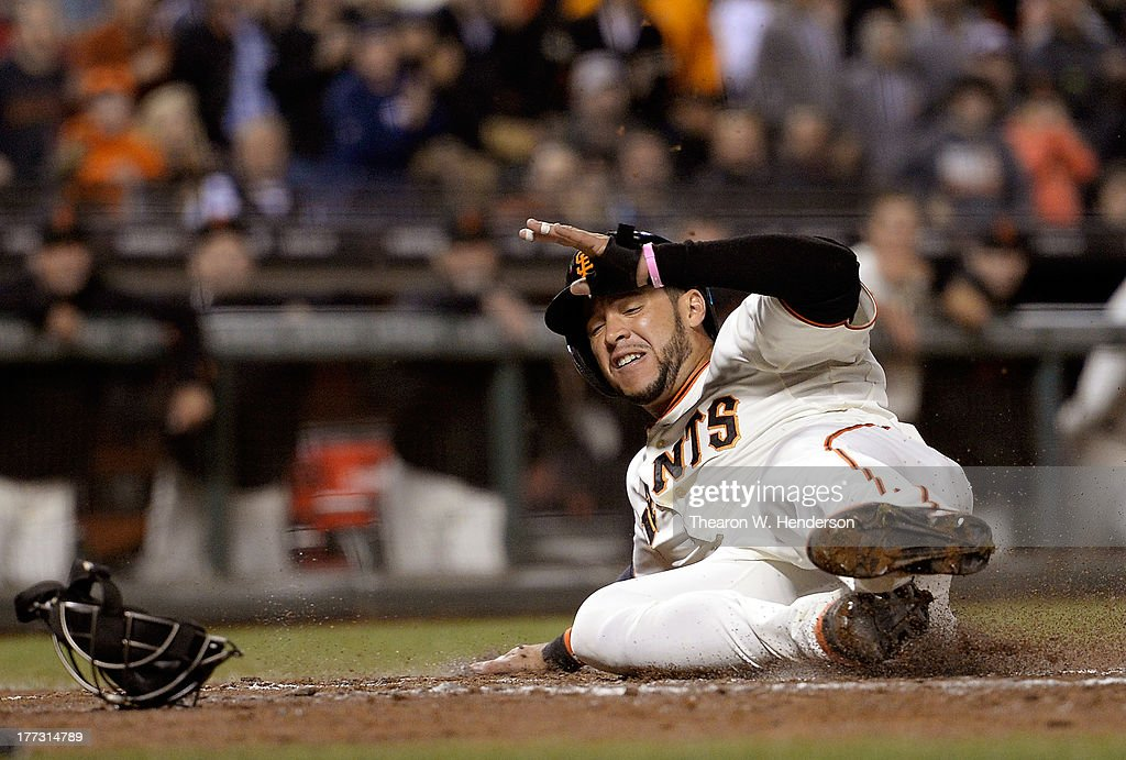 <a gi-track='captionPersonalityLinkClicked' href=/galleries/search?phrase=Gregor+Blanco&family=editorial&specificpeople=4137600 ng-click='$event.stopPropagation()'>Gregor Blanco</a> #7 of the San Francisco Giants scores on a two-run single by Marco Scutaro (not pictured) in the fourth inning against the Pittsburgh Pirates at AT&T Park on August 22, 2013 in San Francisco, California.