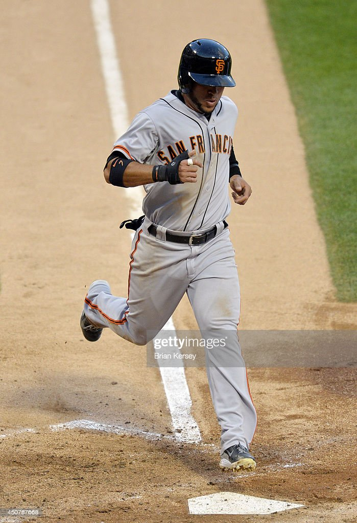 <a gi-track='captionPersonalityLinkClicked' href=/galleries/search?phrase=Gregor+Blanco&family=editorial&specificpeople=4137600 ng-click='$event.stopPropagation()'>Gregor Blanco</a> #7 of the San Francisco Giants scores on an RBI single hit by Buster Posey during the third inning against the Chicago White Sox at U.S. Cellular Field on June 17, 2014 in Chicago, Illinois.