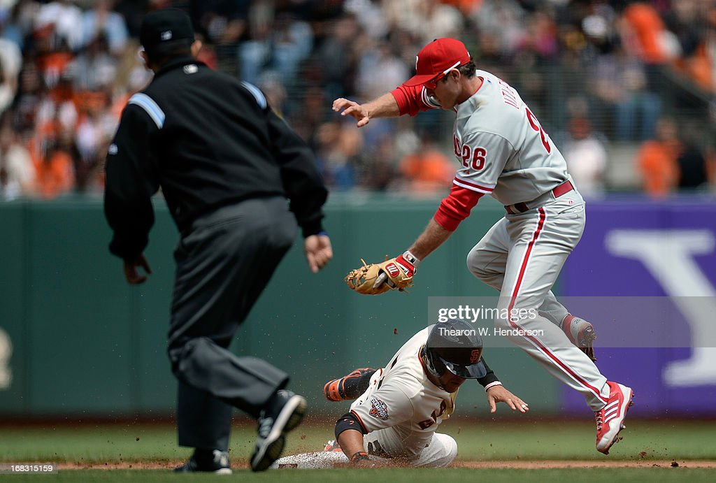 <a gi-track='captionPersonalityLinkClicked' href=/galleries/search?phrase=Gregor+Blanco&family=editorial&specificpeople=4137600 ng-click='$event.stopPropagation()'>Gregor Blanco</a> #7 of the San Francisco Giants steals second base, sliding under the tag of <a gi-track='captionPersonalityLinkClicked' href=/galleries/search?phrase=Chase+Utley&family=editorial&specificpeople=161391 ng-click='$event.stopPropagation()'>Chase Utley</a> #26 of the Philadelphia Phillies in the fifth inning at AT&T Park on May 8, 2013 in San Francisco, California.