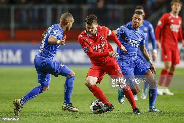 Gregor Breinburg of NEC Nijmegen Mateusz Klich of FC Twente Mohamed Rayhi of NEC Nijmegenduring the Dutch Eredivisie match between FC Twente and NEC...