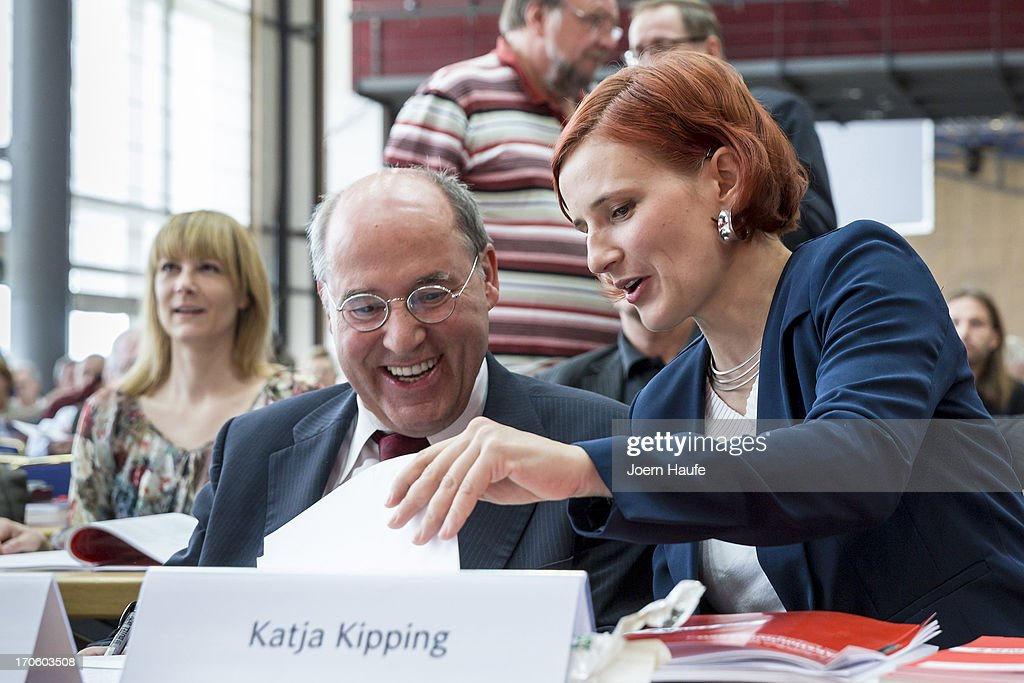 <a gi-track='captionPersonalityLinkClicked' href=/galleries/search?phrase=Gregor+Gysi&family=editorial&specificpeople=240410 ng-click='$event.stopPropagation()'>Gregor Gysi</a>, leader of the Die Linke Bundestag faction, and Katja Kipping, co-Chairwoman of the left-wing Die Linke political party, speak with one another during the party's federal convention on June 15, 2013 in Dresden, Germany. Die Linke, Germany's main left-wing political party, are meeting to decide on their policy program for German federal elections scheduled for September.