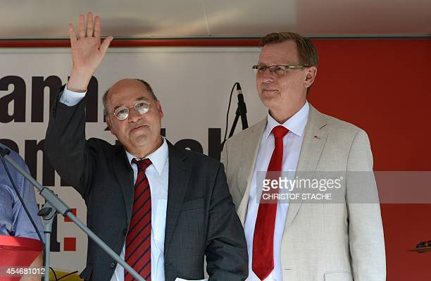 Gregor Gysi of the socialist leftwing political party The Left waves beside Bodo Ramelow top candidate of the German left party 'Die Linke' for the...