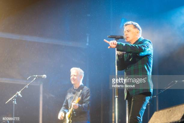 Gregor Philp and Ricky Ross of Scottish pop rock band Deacon Blue perform on stage at Edinburgh Castle on July 22 2017 in Edinburgh Scotland