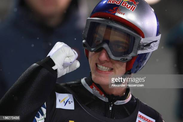 Gregor Schlierenzauer of Austria celebrates after the final round at the FIS Ski Jumping World Cup event of the 60th Four Hills ski jumping...